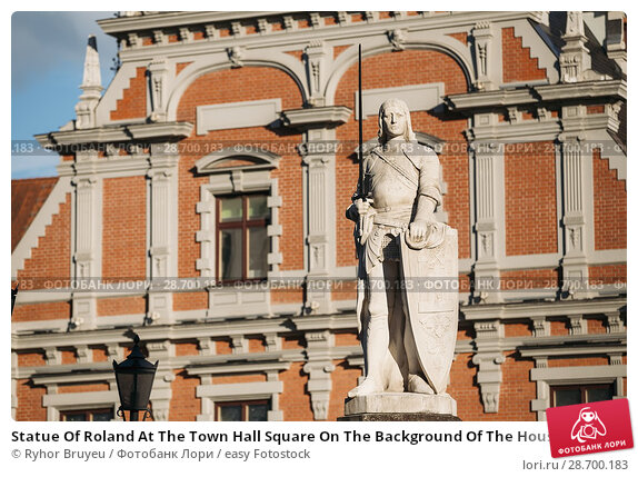Купить «Statue Of Roland At The Town Hall Square On The Background Of The House Of Blackheads In Riga, Latvia. Sunny Summer Day With Blue Sky. Famous Landmark. Old Architecture. Travel Destination.», фото № 28700183, снято 30 июня 2016 г. (c) easy Fotostock / Фотобанк Лори