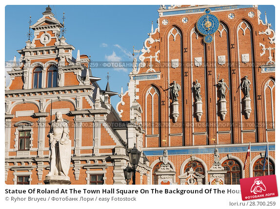 Купить «Statue Of Roland At The Town Hall Square On The Background Of The House Of Blackheads In Riga, Latvia. Sunny Summer Day With Blue Sky. Famous Landmark. Old Architecture. Travel Destination.», фото № 28700259, снято 30 июня 2016 г. (c) easy Fotostock / Фотобанк Лори