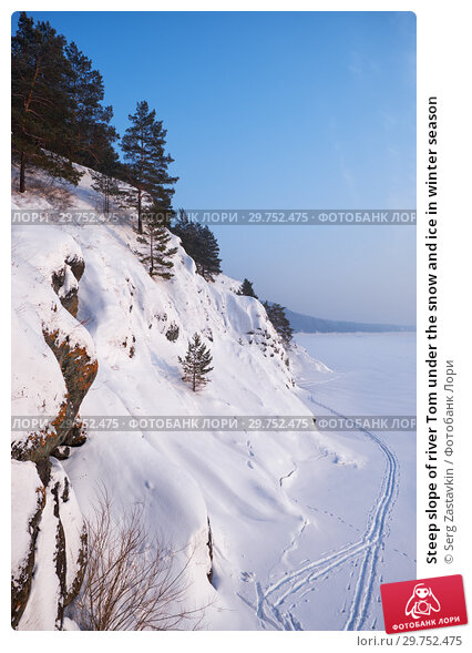 Купить «Steep slope of river Tom under the snow and ice in winter season», фото № 29752475, снято 4 января 2019 г. (c) Serg Zastavkin / Фотобанк Лори