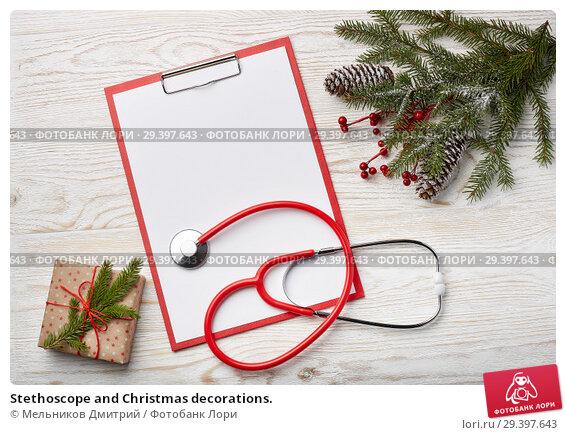 Купить «Stethoscope and Christmas decorations.», фото № 29397643, снято 4 ноября 2018 г. (c) Мельников Дмитрий / Фотобанк Лори