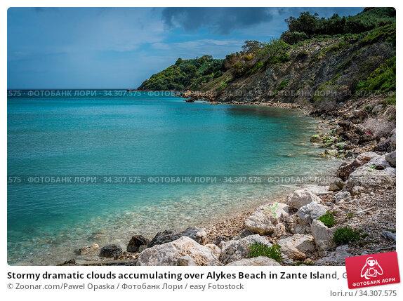 Stormy dramatic clouds accumulating over Alykes Beach in Zante Island, Greece. Стоковое фото, фотограф Zoonar.com/Pawel Opaska / easy Fotostock / Фотобанк Лори