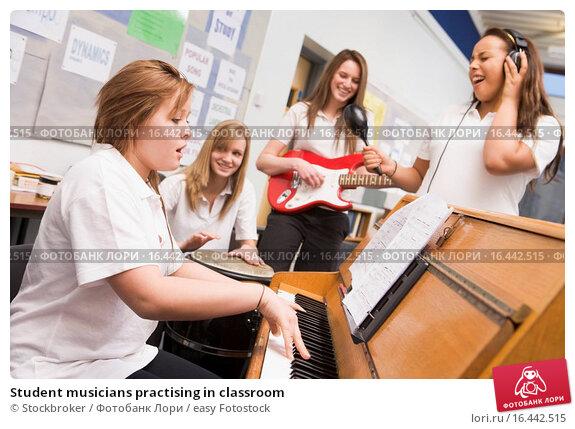 Купить «Student musicians practising in classroom», фото № 16442515, снято 21 июля 2019 г. (c) easy Fotostock / Фотобанк Лори