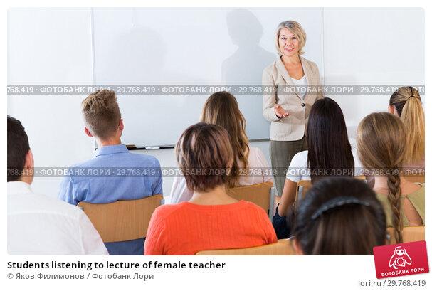 Купить «Students listening to lecture of female teacher», фото № 29768419, снято 22 сентября 2019 г. (c) Яков Филимонов / Фотобанк Лори