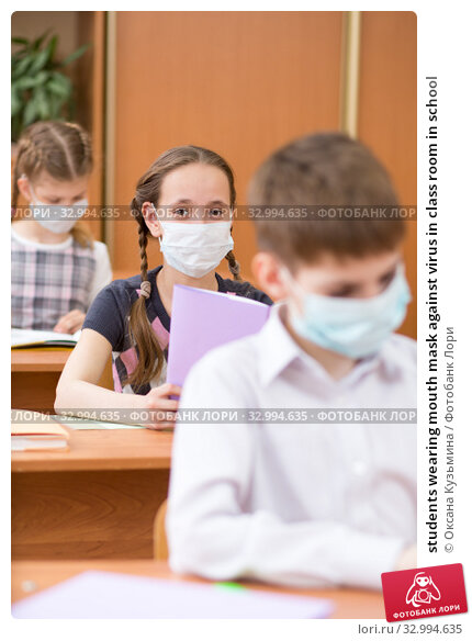 Купить «students wearing mouth mask against virus in class room in school», фото № 32994635, снято 28 января 2020 г. (c) Оксана Кузьмина / Фотобанк Лори