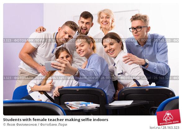 Купить «Students with female teacher making selfie indoors», фото № 28163323, снято 5 октября 2017 г. (c) Яков Филимонов / Фотобанк Лори