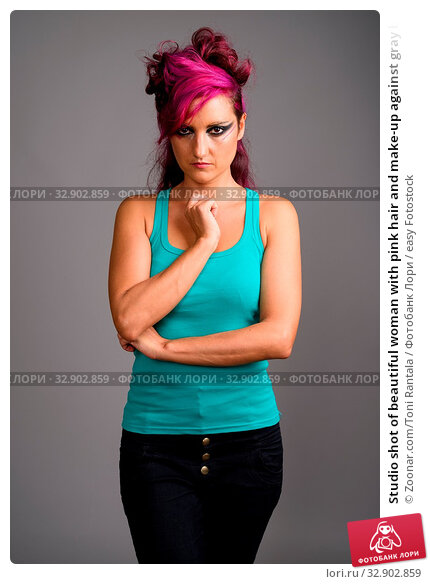 Studio shot of beautiful woman with pink hair and make-up against gray background. Стоковое фото, фотограф Zoonar.com/Toni Rantala / easy Fotostock / Фотобанк Лори