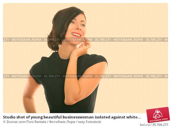 Studio shot of young beautiful businesswoman isolated against white... Стоковое фото, фотограф Zoonar.com/Toni Rantala / easy Fotostock / Фотобанк Лори