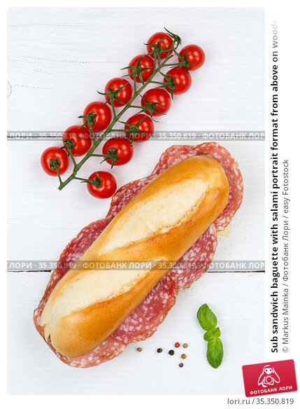 Sub sandwich baguette with salami portrait format from above on wooden... Стоковое фото, фотограф Markus Mainka / easy Fotostock / Фотобанк Лори