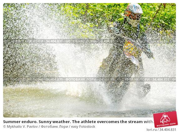 Summer enduro. Sunny weather. The athlete overcomes the stream with... Стоковое фото, фотограф Mykhailo V. Pavlov / easy Fotostock / Фотобанк Лори