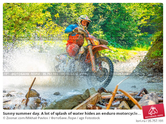 Sunny summer day. A lot of splash of water hides an enduro motorcycle... Стоковое фото, фотограф Zoonar.com/Mikhail Pavlov / age Fotostock / Фотобанк Лори