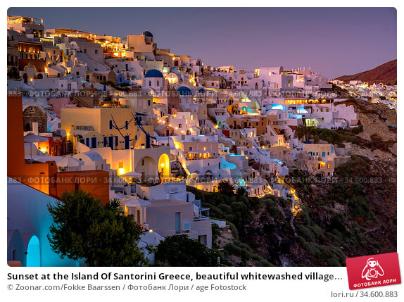 Sunset at the Island Of Santorini Greece, beautiful whitewashed village... Стоковое фото, фотограф Zoonar.com/Fokke Baarssen / age Fotostock / Фотобанк Лори