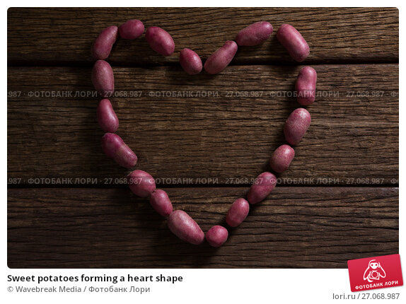 Купить «Sweet potatoes forming a heart shape», фото № 27068987, снято 12 июня 2017 г. (c) Wavebreak Media / Фотобанк Лори