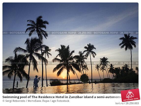 Купить «Swimming pool of The Residence Hotel in Zanzibar island a semi-autonomous part of Tanzania, in East Africa.», фото № 28250003, снято 10 января 2018 г. (c) age Fotostock / Фотобанк Лори