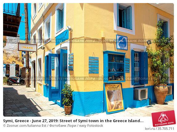 Symi, Greece - June 27, 2019: Street of Symi town in the Greece Island... Стоковое фото, фотограф Zoonar.com/Iulianna Est / easy Fotostock / Фотобанк Лори