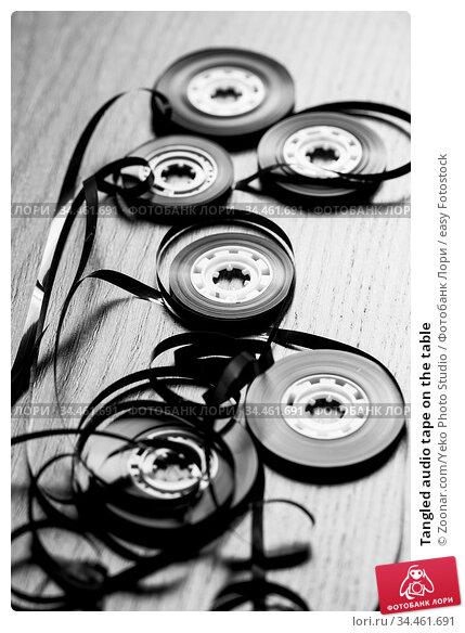 Tangled audio tape on the table. Стоковое фото, фотограф Zoonar.com/Yeko Photo Studio / easy Fotostock / Фотобанк Лори
