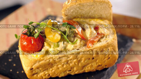 Купить «Tasty snack with tomatoes», видеоролик № 28116127, снято 16 февраля 2018 г. (c) Илья Шаматура / Фотобанк Лори
