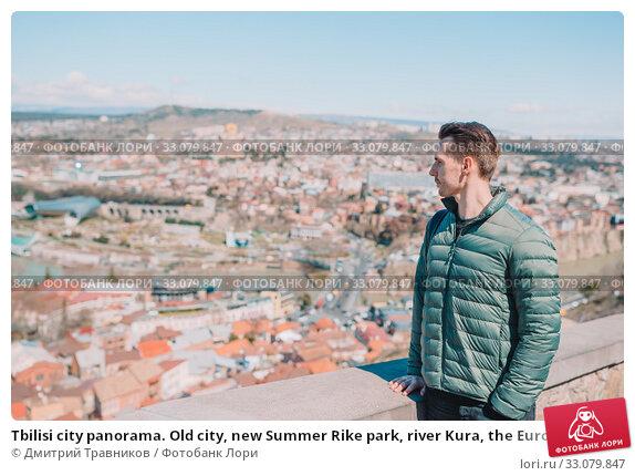 Купить «Tbilisi city panorama. Old city, new Summer Rike park, river Kura, the European Square and the Bridge of Peace», фото № 33079847, снято 21 марта 2019 г. (c) Дмитрий Травников / Фотобанк Лори