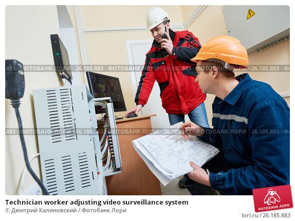 Купить «Technician worker adjusting video surveillance system», фото № 26185883, снято 22 декабря 2016 г. (c) Дмитрий Калиновский / Фотобанк Лори