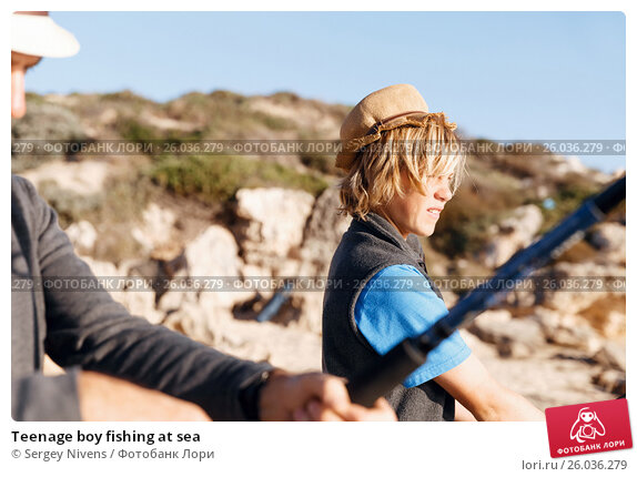 Teenage boy fishing at sea, фото № 26036279, снято 15 апреля 2015 г. (c) Sergey Nivens / Фотобанк Лори