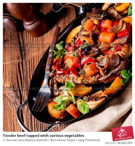 Tender beef topped with various vegetables. Стоковое фото, фотограф Zoonar.com/Darius Dzinnik / easy Fotostock / Фотобанк Лори