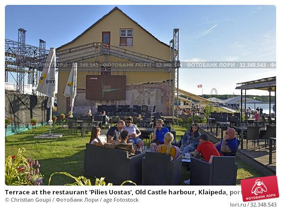 Купить «Terrace at the restaurant 'Pilies Uostas', Old Castle harbour, Klaipeda, port city on the Baltic Sea, Lithuania, Europe.», фото № 32348543, снято 23 июня 2019 г. (c) age Fotostock / Фотобанк Лори