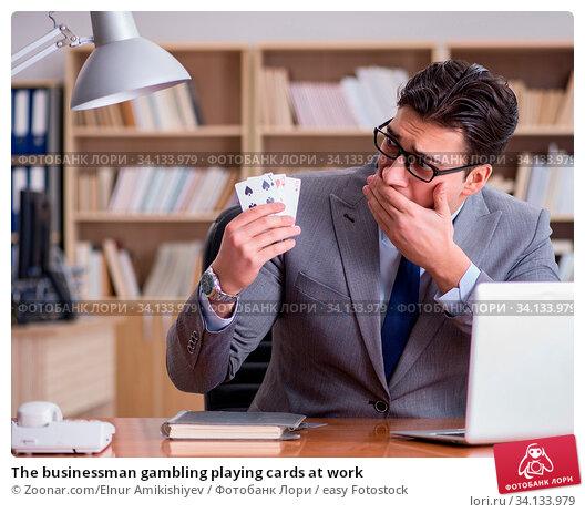 Купить «The businessman gambling playing cards at work», фото № 34133979, снято 6 июля 2020 г. (c) easy Fotostock / Фотобанк Лори