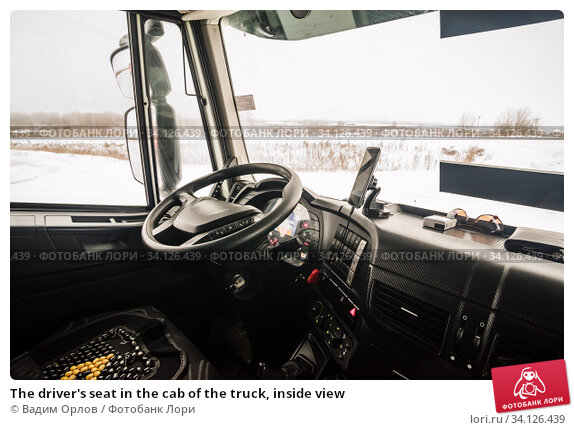 Купить «The driver's seat in the cab of the truck, inside view», фото № 34126439, снято 17 декабря 2019 г. (c) Вадим Орлов / Фотобанк Лори