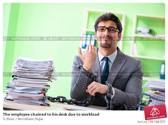 Купить «The employee chained to his desk due to workload», фото № 29138571, снято 11 мая 2018 г. (c) Elnur / Фотобанк Лори