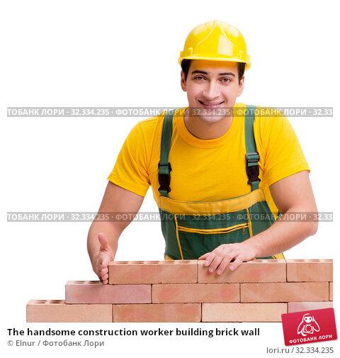 Купить «The handsome construction worker building brick wall», фото № 32334235, снято 5 ноября 2016 г. (c) Elnur / Фотобанк Лори