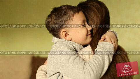 Купить «The happy boy tenderly embraced his mother», видеоролик № 26035443, снято 20 апреля 2017 г. (c) Олег Башкир / Фотобанк Лори