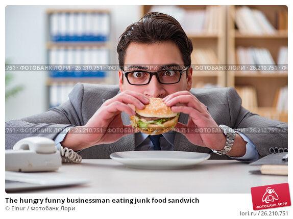 Купить «The hungry funny businessman eating junk food sandwich», фото № 26210751, снято 30 января 2017 г. (c) Elnur / Фотобанк Лори