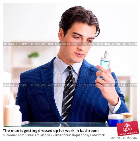 The man is getting dressed up for work in bathroom. Стоковое фото, фотограф Zoonar.com/Elnur Amikishiyev / easy Fotostock / Фотобанк Лори
