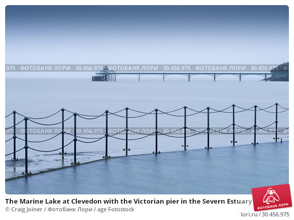 The Marine Lake at Clevedon with the Victorian pier in the Severn Estuary beyond. North Somerset, England. Стоковое фото, фотограф Craig Joiner / age Fotostock / Фотобанк Лори