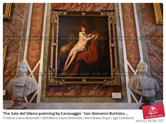 The Sala del Sileno painting by Caravaggio ' San Giovanni Battista... Редакционное фото, фотограф Maria Laura Antonelli / AGF/Maria Laura Antonelli / age Fotostock / Фотобанк Лори