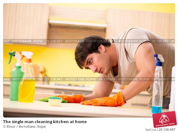 Купить «The single man cleaning kitchen at home», фото № 29138947, снято 13 июня 2018 г. (c) Elnur / Фотобанк Лори