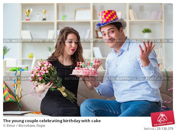 Купить «The young couple celebrating birthday with cake», фото № 29138379, снято 1 апреля 2017 г. (c) Elnur / Фотобанк Лори