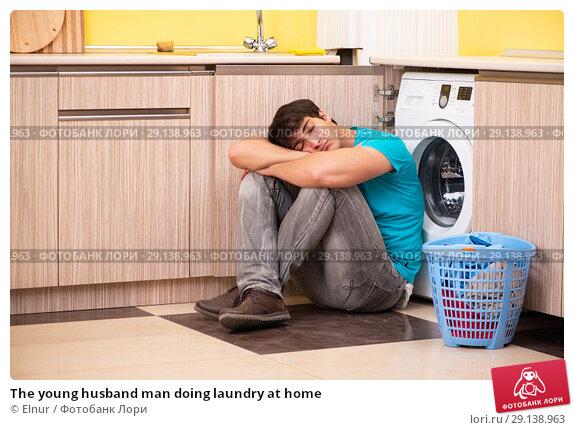 Купить «The young husband man doing laundry at home», фото № 29138963, снято 13 июня 2018 г. (c) Elnur / Фотобанк Лори