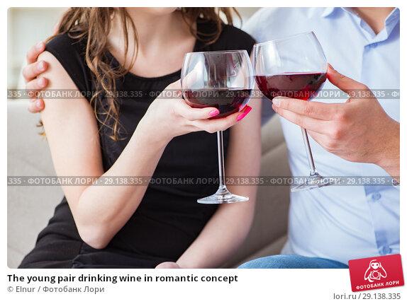 Купить «The young pair drinking wine in romantic concept», фото № 29138335, снято 1 апреля 2017 г. (c) Elnur / Фотобанк Лори
