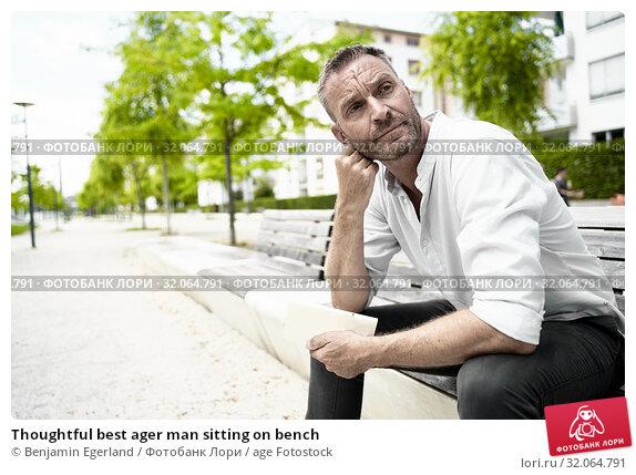 Thoughtful best ager man sitting on bench. Стоковое фото, фотограф Benjamin Egerland / age Fotostock / Фотобанк Лори