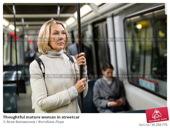 Thoughtful mature woman in streetcar. Стоковое фото, фотограф Яков Филимонов / Фотобанк Лори