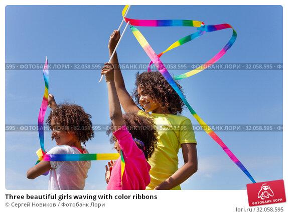 Three beautiful girls waving with color ribbons. Стоковое фото, фотограф Сергей Новиков / Фотобанк Лори