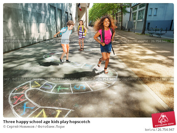Купить «Three happy school age kids play hopscotch», фото № 26754947, снято 17 июня 2017 г. (c) Сергей Новиков / Фотобанк Лори