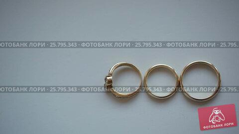 Three wedding rings, видеоролик № 25795343, снято 16 марта 2016 г. (c) Алексей Макаров / Фотобанк Лори