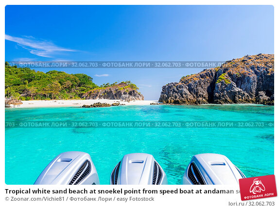 Tropical white sand beach at snoekel point from speed boat at andaman sea indian ocean Myanmar and Thailand. Стоковое фото, фотограф Zoonar.com/Vichie81 / easy Fotostock / Фотобанк Лори