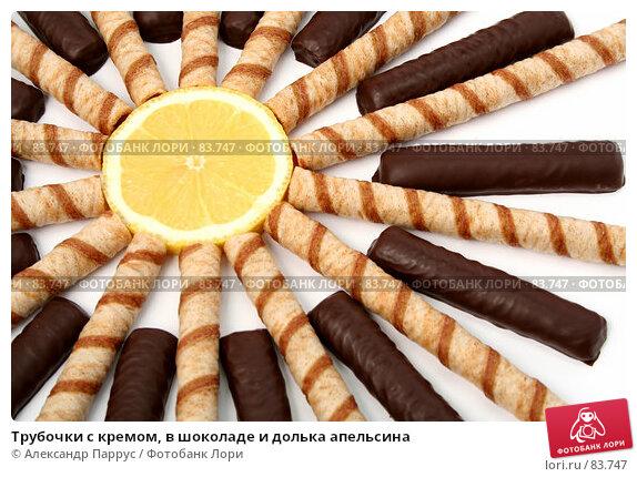 Трубочки с кремом, в шоколаде и долька апельсина, фото № 83747, снято 9 января 2007 г. (c) Александр Паррус / Фотобанк Лори
