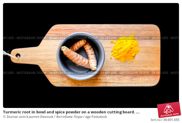 Turmeric root in bowl and spice powder on a wooden cutting board. ... Стоковое фото, фотограф Zoonar.com/Laurent Davoust / age Fotostock / Фотобанк Лори