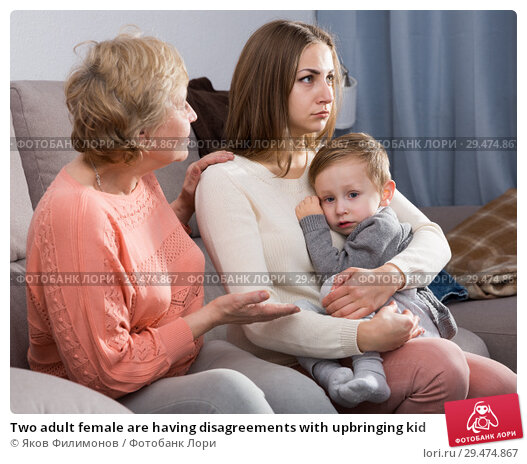 Купить «Two adult female are having disagreements with upbringing kid», фото № 29474867, снято 15 февраля 2018 г. (c) Яков Филимонов / Фотобанк Лори