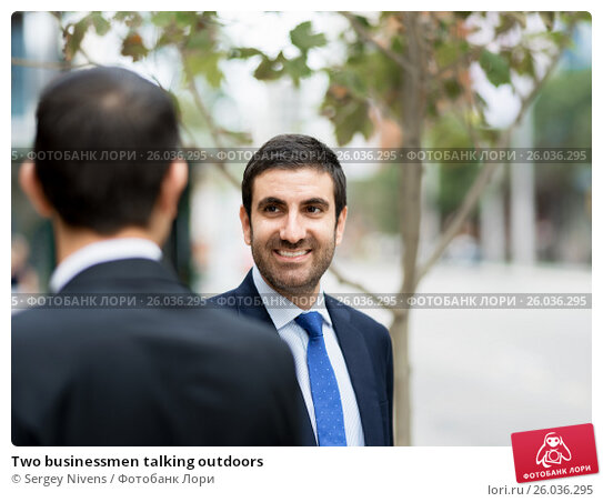 Two businessmen talking outdoors, фото № 26036295, снято 4 апреля 2015 г. (c) Sergey Nivens / Фотобанк Лори