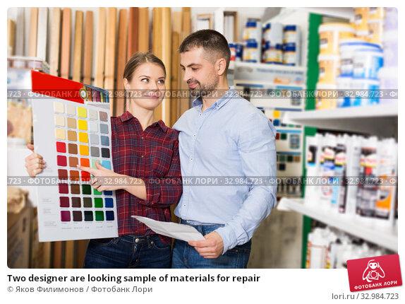 Купить «Two designer are looking sample of materials for repair», фото № 32984723, снято 16 февраля 2018 г. (c) Яков Филимонов / Фотобанк Лори