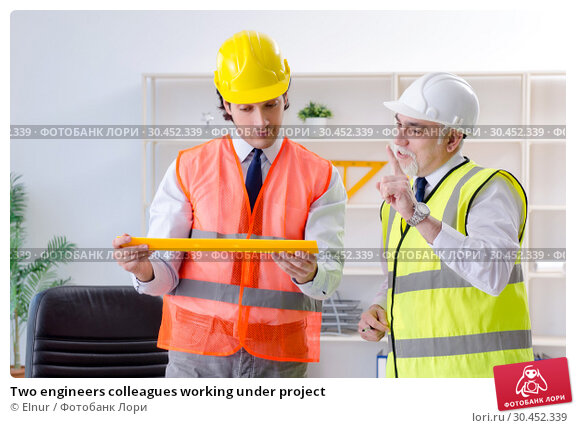 Two engineers colleagues working under project. Стоковое фото, фотограф Elnur / Фотобанк Лори